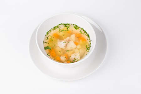walleye: Soup of the Lake walleye with fish and carrot in white bowl