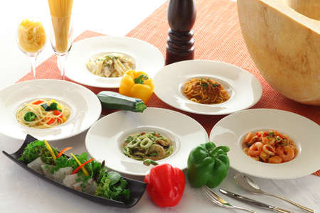 wedding feast: Soup, bread, salad, dessert with seafood and noodle pasta on white platters meal Stock Photo