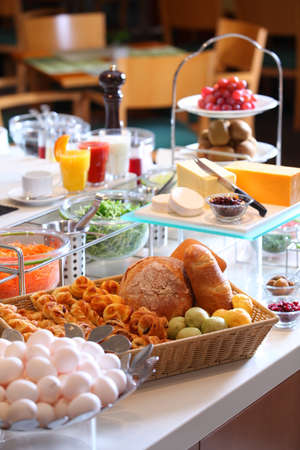 wedding feast: Superbreakfast buffet with bread, egg, cake, juice, bacon and cheese on table in restaurant Stock Photo