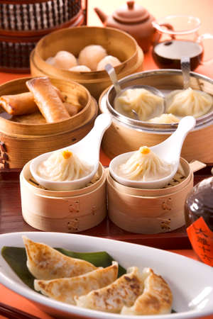 Chinese Dim Sum shrimp dumplings on white dish in restaurant Stock Photo