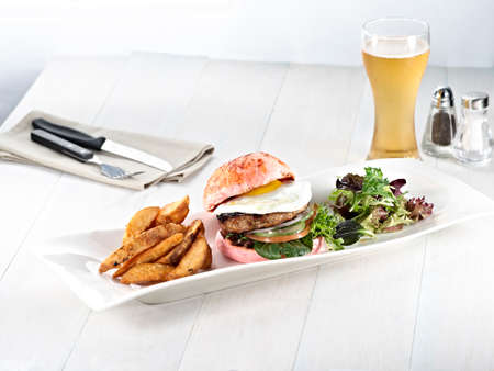 Beetroot Smoked Paprika with burger, beef, lettuce and beer on white wooden table