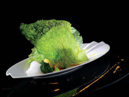 Crispy fried cabbage and sprout vegetables with Argan oil on white platter 스톡 콘텐츠