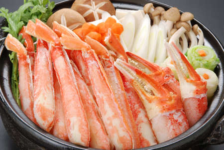crab pot: Raw fresh cold snow crab pot set with claws, legs, mushroom and onion in big black stew