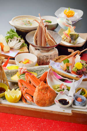 hairy: Meal of red crab with tempura, lemon, mushroom, wasabi and sauce on wooden tray