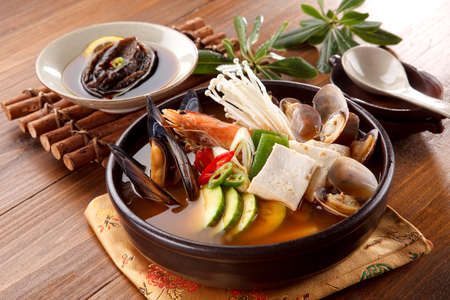crab pots: Seafood hot pot of overture jangjeongsik with blue mussel, clams, shrimp, mushroom, abalone and herbs Stock Photo