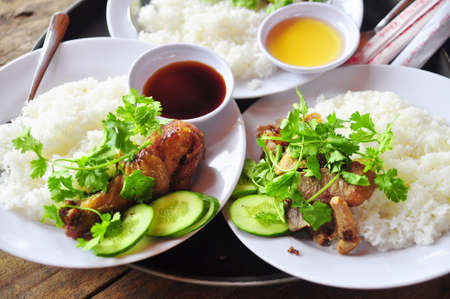 Vietnamese broken rice or com tam with fried chicken legs, pork and herbs Stok Fotoğraf