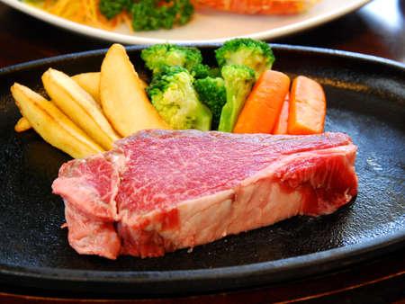Fresh raw beef with fried potatoes and cauliflower