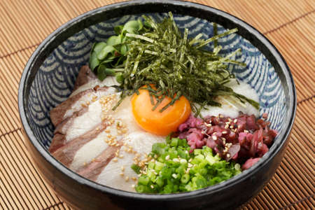 Bowl of ramen udon noodle with eeg, onion, pork and sprouts Stock Photo