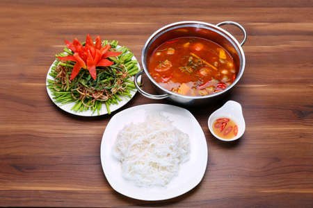 Prepared hot pot of seafood in Thai style with vermicelli, fish sauce and morning glory vegetables