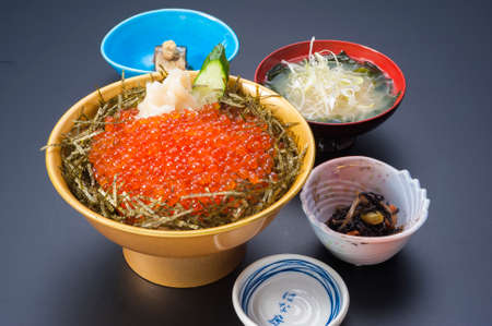 Bowl of red caviar sushi with seaweeds soup Stock Photo