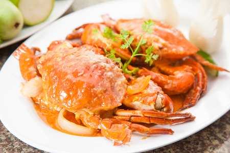 Fried red crab soup with herbs on white dish