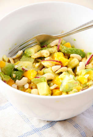 Grilled food and additives with avocado, beans, peas and corn Stock Photo