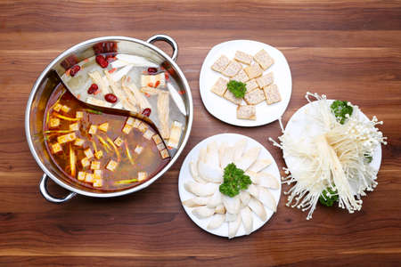Prepared hot pot of mushroom with double style on the table