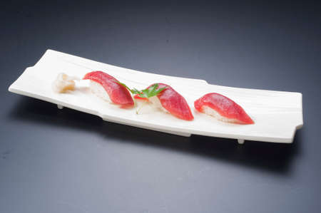 Sushi meal with tuna, rice, fried fish, squid, maki and seaweed soup 版權商用圖片
