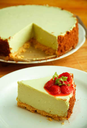 Green tea cheesecake with strawberry on white dish