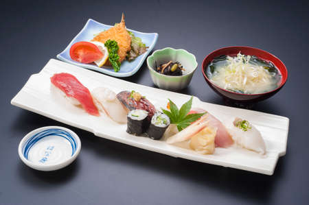 Sushi meal with tuna, rice, fried fish, squid, maki and seaweed soup Stock Photo