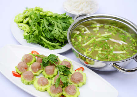 Prepared hot pot of fish ball with bitter melon on white platter