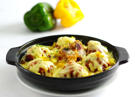 Hot chili pork ribs baked with cheese in black stew