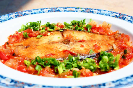 Mackerel braised with tomato sauce and onion Stock Photo