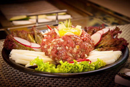 Korean fresh beef with egg, radish, lettuce and vegetables