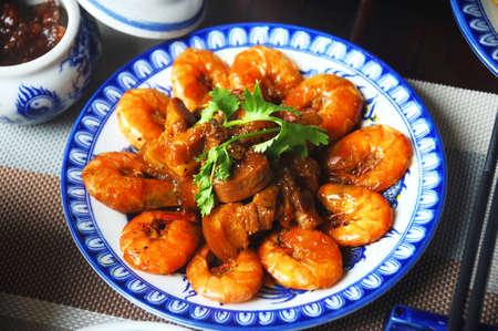 Braised shrimp with pork on white platter