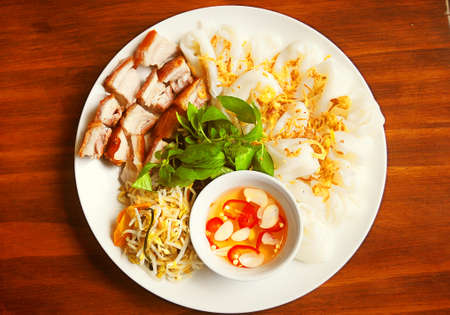 Steamed rice paper or banh uot with grilled pork, fish sauce and sprouts