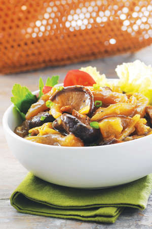 White bowl of sauteed mushroom with stir fried beef