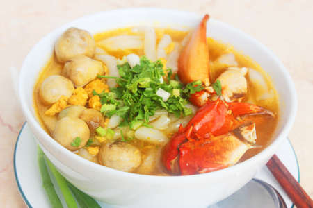 Vietnamese noodle with crab and mushroom or banh canh cua in white bowl