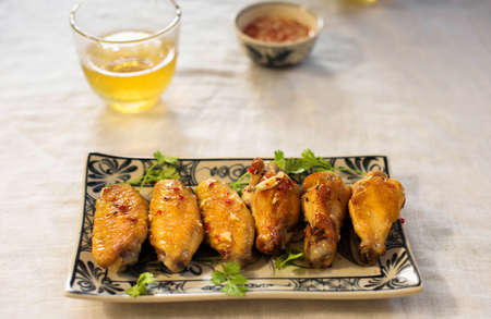 Fried chicken wings with lettuce and fish sauce