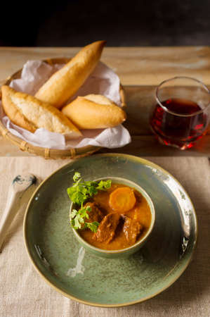 Vietnamese beef stew with carrot and fresh bread
