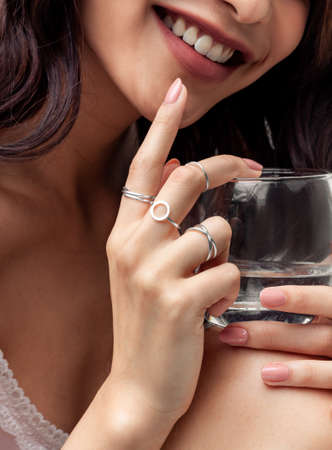 Beautiful young girl with nightgown posing hand wearing rings and jewellery Stock fotó