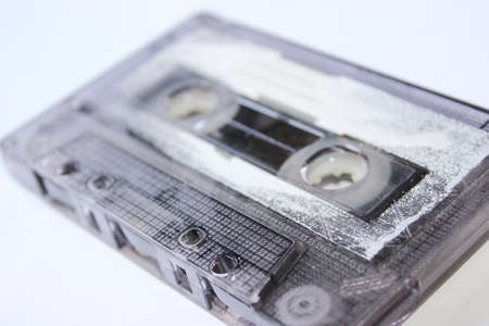 Old audio cassette on white background
