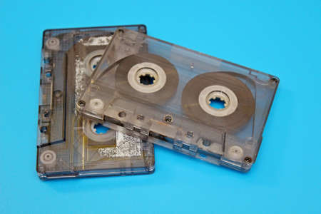 Old audio cassettes located on a blue background