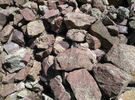 Stone background large cobblestone pile of stones background