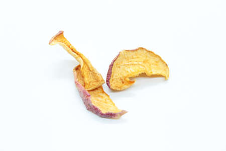 Dried apples are located on a white background Banco de Imagens