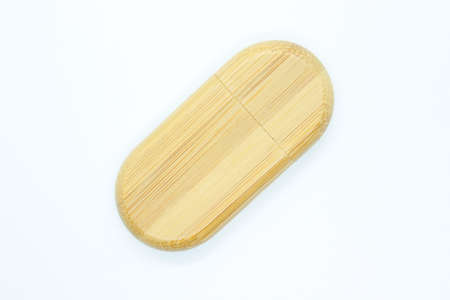 Wooden flash drive located on a white background