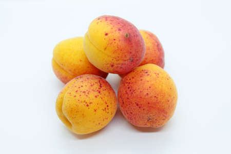 beautiful tasty fresh apricots located on a white background