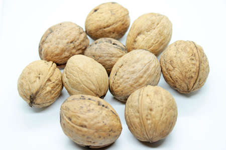 Ripe walnuts located on a white background