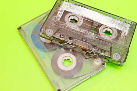 Old audio cassettes located on a green background