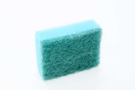 Sponges for washing dishes located on a white background