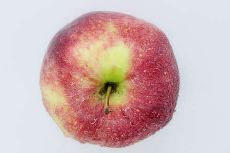 Delicious ripe red juicy beautiful apple located on a white background