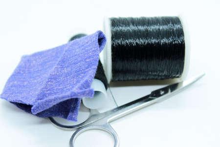 Black thread snort stools fabric arranged on a white background 免版税图像