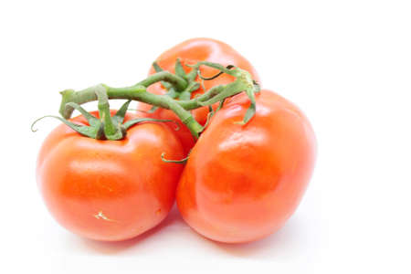 Beautiful ripe red tomatoes on white 免版税图像