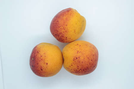 Ripe beautiful apricots are located on a white background 免版税图像