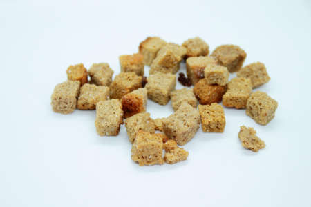 Golden rye crackers are located on a white background