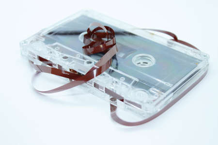 The old audiotape is located on a white background magnetic film