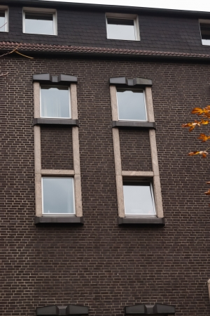 Windows in the braun bricks wall in Dortmund, Germany photo