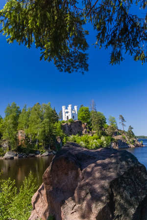 White castle on the rock in Monrepo park in Vyborg, Russia photo
