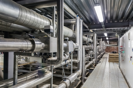 industry inside: Pipes and other building services in a industrial building Stock Photo