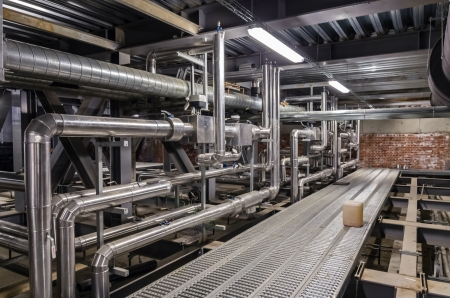 Pipes and other building services in a industrial building Stok Fotoğraf